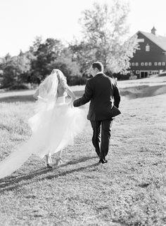 Holding her dress. photography: Judy Pak Photography - judypak.com  Read More: http://www.stylemepretty.com/2014/02/25/elegant-farm-wedding-in-the-berkshires/