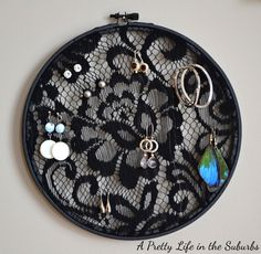 Earring holder using lace, embroidery hoop, and spray paint :)