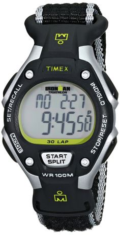 Timex Women's T5K8359J Ironman Rugged Resin Watch with Nylon Band. Round resin watch in gray and black with striped nylon band and hook-and-loop closure. Quartz movement with digital display. Acrylic crystal dial window. Features 100-hour chronograph, 30-lap memory recall, 24-hour countdown, and black pushers. Water resistant to 330 feet (100 meters).