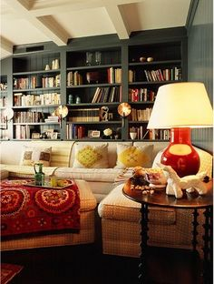 Den by Katie Ridder... I love the wall color and the warm tone accessories.  Oh, and the book wall!