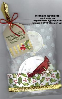 """Handmade gift bag using Stampin' Up! products - Joyful Season Photopolymer Stamp Set, Season of Cheer Designer Series Paper, Sketched Dots Tag a Bag Gift Bags, 3/8"""" Glitter Ribbon, Snowflake Elements, Home for Christmas Enamel Dots, Winter Wonderland Designer Vellum Stack, Ornate Tag Topper Punch, and Thick Baker's Twine.  By Michele Reynolds, Inspiration Ink.  #stampinup #inspirationink #joyfulseason #giftbag #holly #cardinal #snowflake"""