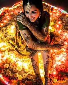 So stunning | Trending on the WedMeGood app shot by @chetna_i | #mehendi #bridalportrait #candid #photography #weddingphotography #instabride #indianbride #mehendi #light #wedding #marigold