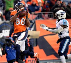 Description of . Denver Broncos wide receiver Demaryius Thomas (88) scores a touchdown in the third quarter.   (Photo by Hyoung Chang/The De...