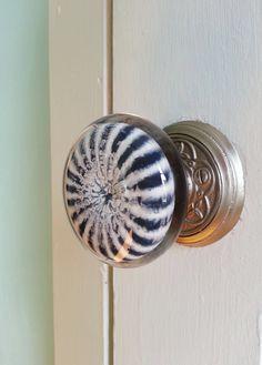 *Handmade glass doorknob by New Morning Glass Studio.  *Black and white striped doorknob on satin nickel base.  *Doorknobs approx. 2 3/4 diameter