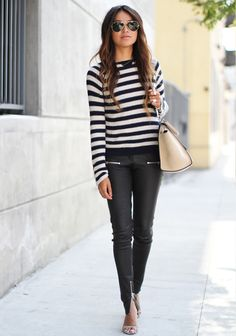 Julie Sarinana [Sincerely Jules] in a Rebecca Taylor striped pullover, Anine Bing leather skinnies, and Isabel Marant heels.