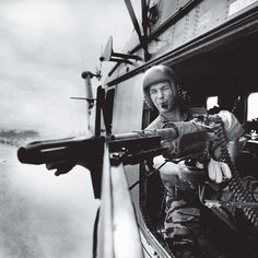 Vietnam, 1965: Lance Cpl. James C. Farley, helicopter crew chief in the US Army. Part of a series published in TIME magazine as the US mounted their fight in Southeast Asia.