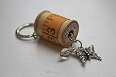 Scissor Fob/Key Chain with vintage wooden spool and measuring tape - adorned with a butterfly charm and bobble. via Etsy