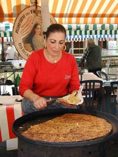 THERÈSE THE QUEEN OF SOCCA Serving up her thin crispy chickpea crêpe  MARCHÉ COURS SALEYA VIEUX NICE