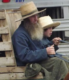 Amish father and son working together