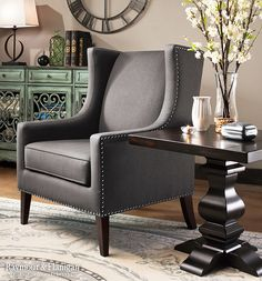 Simultaneously classic and chic, the new Wimberley accent chair makes a gorgeous addition to your living space. Its timeless look takes a traditional wingback chair design and updates it with track arms and tapered feet for a stunning transitional look.