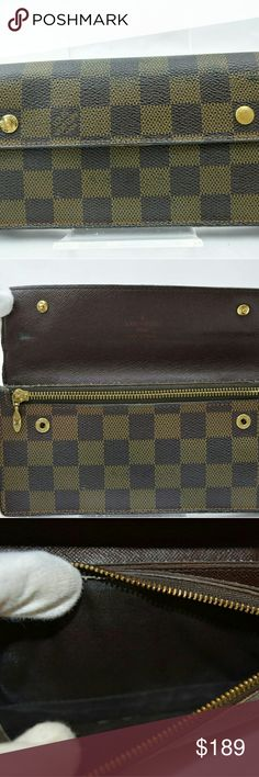 Louis Vuitton Long Wallet Damier TH0075- 10184 Outside: Noticeable rubs on the edges,Noticeable tear on the edge,Noticeable frays at the corner,Noticeable color fade on the whole parts, Noticeable stain on the right side. Inside: Noticeable rubs in the coin case, Minor tear in the card case, Noticeable rub on the back of the flap, Minor stains on the whole parts, Noticeable stains in the coin case. Zipper works properly. Metal parts: Noticeable scratches on the almost all of metal parts…