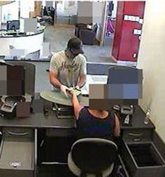"""On Aug 24, 2016, at approx 2:10 pm, a lone male entered a bank on Earl Armstrong Road/River Road. Suspect described as white male, tanned & fit with hairy hands, English speaking with no accent, approx. mid 20's, 5'11""""-6'0"""", 200 lbs, wearing a black baseball hat, dark aviator sunglasses, a black mask/bandana with white design, a light grey T-shirt with """"Harley"""" in red. If you have info, call 613-236-1222 x5116 or Crime Stoppers at 1-800-222-8477."""