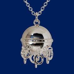 Cradle ball protects its wearer from evil spirits and the tinkle of the small rings brings good luck. Evil Spirits, Small Rings, Wearable Technology, Finland, Design Trends, 925 Silver, Jewelry Design, Ceiling Lights, Jewels