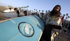 Father Matthew Munoz(grandson of John Wayne),and his Lady of Guadalupe surf board. Sooooo cool.