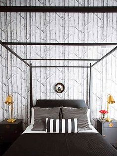 This wallpaper is a bold statement in this black and white decorated bedroom