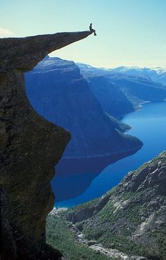 Trolltunga (meaning: troll's tongue) is a piece of rock that juts out horizontally from a mountain above Skjeggedal Valley, Odda, Norway. beautiful-places-to-visit Places Around The World, Oh The Places You'll Go, Places To Travel, Places To Visit, Around The Worlds, Travel Destinations, Lofoten, Beautiful World, Beautiful Places