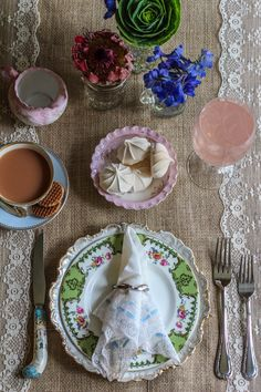 MisMismatched china, bold florals, lace accents, and scrumptious finger-foods are all the ingredients needed to create a devastatingly romantic tea party wedding reception. Table design inspired by the elegant dreaminess of Essense of Australia's vintage Lace over Lustre Satin wedding dress.