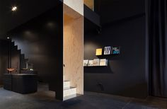 a floating staircase defines interior of bazar noir by hidden fortress