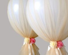 Giant balloons with tulle and flowers