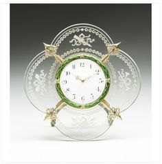 Created by Fabergé workmaster Mikhail Evlampievich Perkhin (1860-1903) around 1900, this desk clock of carved rock crystal is mounted with gold, silver-gilt, enamel, rose diamonds and rubies.  It was presented to Queen Victoria by Tsarina Alexandra Feodorovna, her granddaughter,  in 1900.