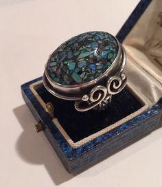 A personal favourite from my Etsy shop https://www.etsy.com/uk/listing/256442141/vintage-silver-mosaic-opal-ring-1930s