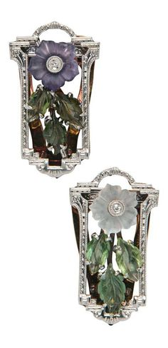 A Pair of Art Deco 14kt Gold, Glass, and Diamond Dress Clips. Each with a flower, one purple, one frosted clear, in period Tiffany & Co. box, lg. 1 in. #ArtDeco #DressClips