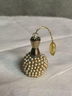 Un montón de perlas miniatura Perfume botella