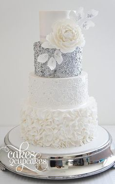 This wedding cake has it all, ruffles, lace, glitter and floral detail, it truly…