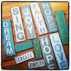 Scrap wood + stencils + paint = sweet signs! If you don't have any scrap wood, lots of places give away their old pallets for free!