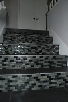 Ever do tile on stairs?? Try it! The treads are through body porcelain, the risers are 1x2 glass mosaics. Designed by our saleswoman Oriana.