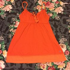 NEW LISTING  Hollister Orange Top Barely used! Needs a new loving home  60% cotton, 40% polyester. Machine wash cold, tumble dry low, low iron. ⛔️ NO TRADES, NO PAYPAL, NO MERCARI, NO HOLDS ⛔️ smoke free, pet free home  let me know if you have other questions  PLEASE MAKE OFFERS THROUGH THE OFFER BUTTON. Hollister Tops