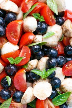 A perfect summer entertaining recipe featuring fresh blueberries, cherry tomatoes, basil, and mozzarella.