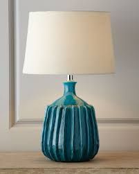 "Beautiful ocean blue ceramic ribbed lamp just arrived! It is 15"" in diameter x 27"" in height, featuring a cream-colored natural burlap shade. Available at Cerulean Interiors~ 850-249-3873~ we price match and offer free shipping!"