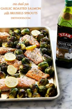 One Sheet Pan Garlic Roasted Salmon with Brussels Sprouts - Incredibly delicious, garlicky, super flavorful one-pan dinner with oven-roasted salmon and brussels sprouts.