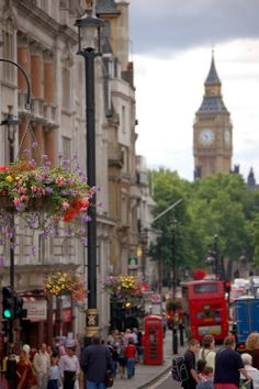 Big Ben - I actually take this picture every time we go to London from the same vantage point. Love the hanging flower baskets.
