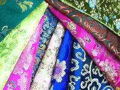 brocade : a heavy, exquisite, jacquard-type fabric with an all-over raised pattern or floral design. (bernice fmm 1b2)