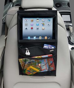 Prop up a tablet for backseat movie watching or entertainment with this clever holder. It mounts on the back of the driver's or passenger side headrest for optimal viewing and keeps it safely off the floor and away from potentially sticky fingers. A bottom pocket offers a pocket for extra storage. 10.5'' W x 20'' HImported