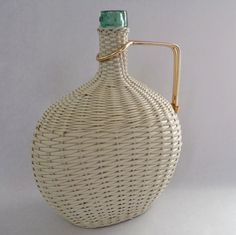J. Albinana retro bottle covered with woven scoubidou (vinyl), gold handle, wooden base - vintage item from the 1960s