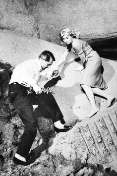 The final chase scene in North By Northwest (1959) was not shot on Mt. Rushmore;Alfred Hitchcock wanted to film there but couldn't gain permission to shoot an attempted murder on a national monument. The scene instead was shot in the studio on a giant replica of Mt. Rushmore. Everything was filmed carefully, so as to avoid associating the faces of the monument with the violence occurring in the film. Classic Hollywood, Old Hollywood, Feminine Face, Photography Movies, North By Northwest, The Searchers, Lights Camera Action, Cary Grant, Alfred Hitchcock