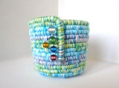 yarn/coiled/with glass beads