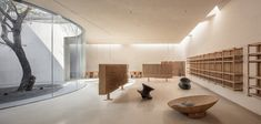 World Architecture Community News - Waterfrom Design creates peaceful interior with wooden furnitures for tea community center in China Xiamen, Cultural Architecture, Church Architecture, Minimalist Architecture, Glass Pavilion, Journal Du Design, Architectural Features, Ground Floor, Dining Area