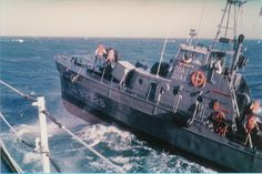 A US Coast Guard 82-foot patrol boat (RVN SQ 1) comes alongside USCGC Half Moon (WHEC-378 - RVN Sq 3) for replenishment during Operation Market Time off the coast of South Vietnam. Photograph courtesy of Russ Worthington.