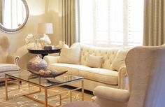 Lovve the gold coffee table & the mirror... Curtains too...
