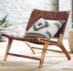 Our low, woven, leather chair makes lounging and inescapable temptation. Leather straps in a rich caramel color are woven onto a white cedar hardwood frame and secured with bronze rivets.