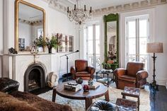 Louis Philippe mirror French vintage leather club chairs Paris apartment