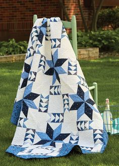 Author Marie Bostwick is also a quiltmaker! She designed this blue and white quilt, From Here to Home, featuring Flying Geese and LeMoyne Stars. It's like a piece of art!