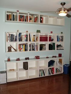 "Ikea ""Billy shelves.  Start at bottom and build up.  open space is same size as a Billy shelf.  YOu can use trim to fill in gaps if needed."