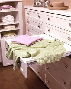 Folding Station     When your closet includes a flat surface for folding clothes, you're more likely to keep shirts and sweaters neatly stacked. Rather than moving small decorative items from countertop space, these homeowners customized a drawer that pulls out to create folding space. When the chore is done, the drawer can be closed