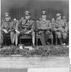 German officials (from left to right) Hinrich Lohse, Otto-Heinrich Drechsler, Alfred Rosenberg, and Eberhard von Medem on a visit to the Baltic States, 1942. Note Drechsler's artificial legs result of serious battlefield wounds in WW1.