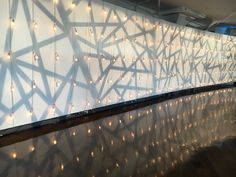 geometric pattern gobo layered with string lights by NYC Wedding Lighting